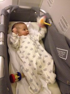 Madeleine playing in Air NZ Bassinet
