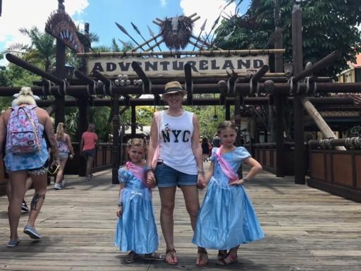 photo of us outside Adventureland at Magic Kingdom