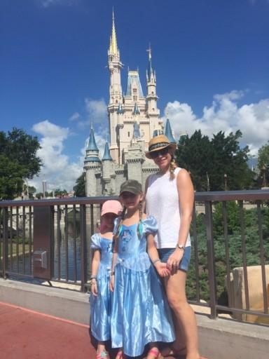 photo of us outside Disney's Magic Kingdom Castle