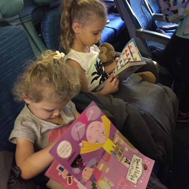 girls reading on airplane