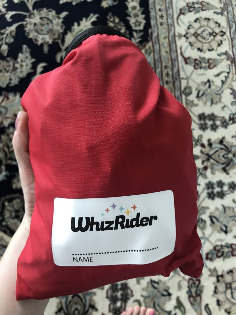photo of a red WhizRider pouch that carries a WhizRider